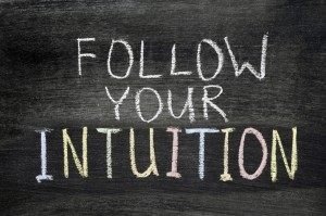 follow your intuition phrase handwritten on blackboard